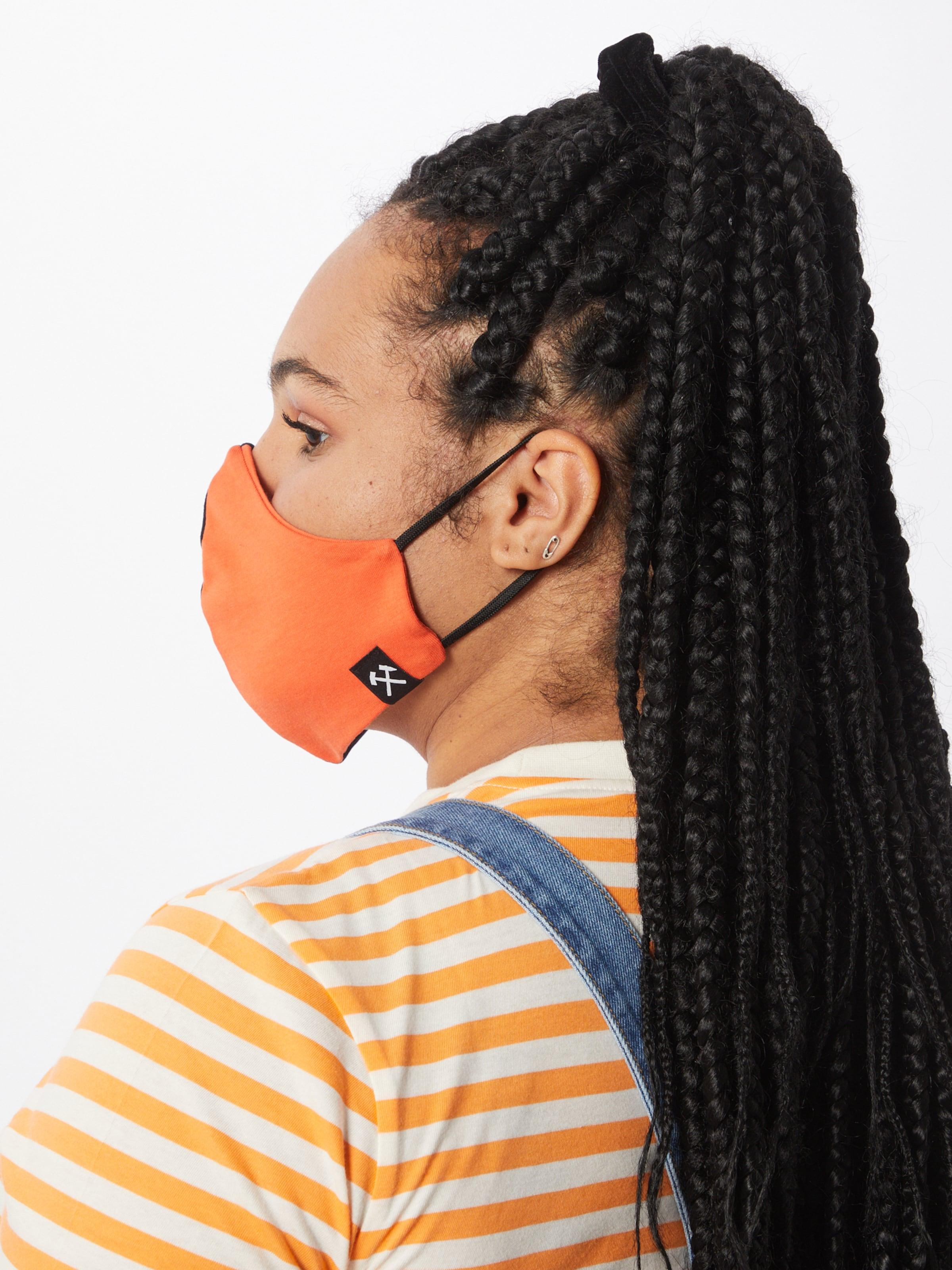 Grubenhelden Szövetmaszk 'Colourblock' narancs / fekete színben