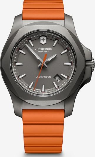 VICTORINOX Montre à affichage analogique 'I.N.O.X. Titanium' en gris / orange foncé, Vue avec produit