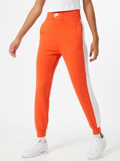 Nike Sportswear Spodnie w kolorze pomarańczowy / białym: Widok z przodu