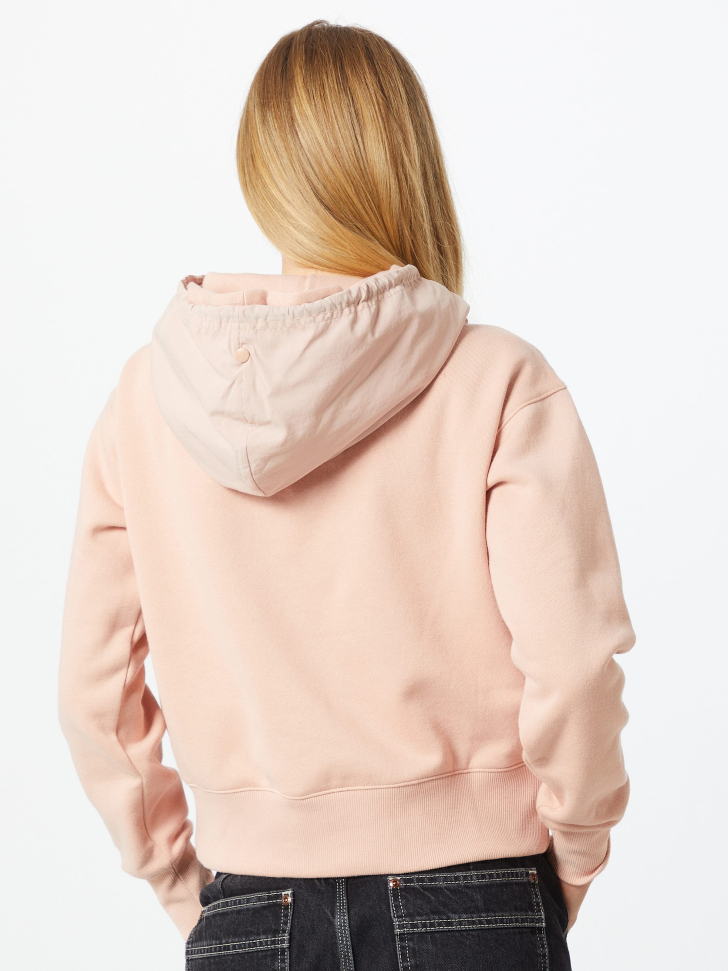 Champion Authentic Athletic Apparel Sweatshirt in rosa / schwarz
