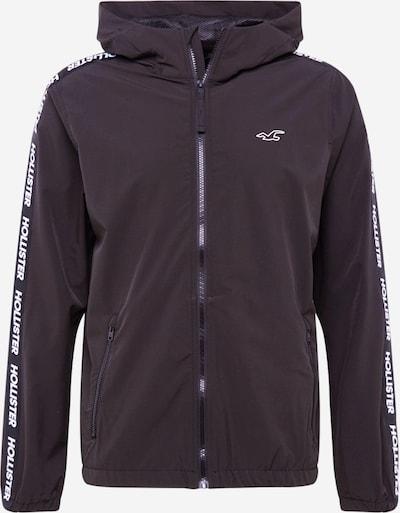 HOLLISTER Prehodna jakna | črna / bela barva, Prikaz izdelka
