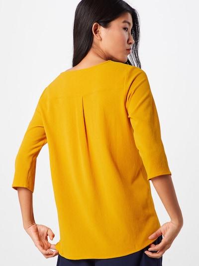 ABOUT YOU Bluzka 'Emmi' w kolorze musztardowym: Widok od tyłu