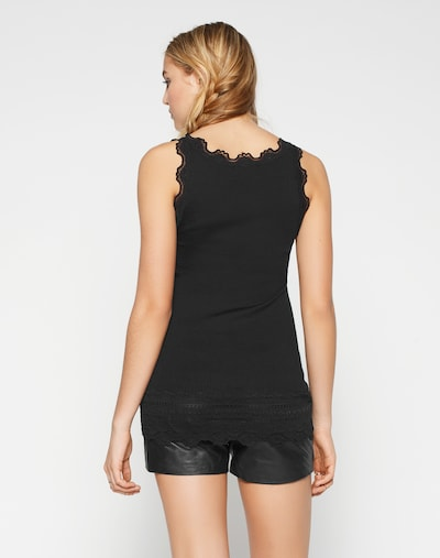 Top rosemunde di colore nero: Vista da dietro