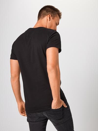 tigha T-Shirt 'Hein' en noir: Vue de dos