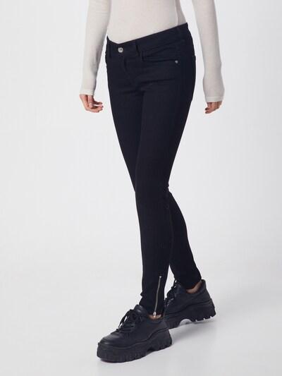 DIESEL Jean 'SLANDY-LOW-ZIP' en noir, Vue avec modèle