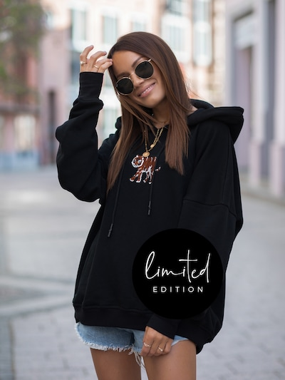 ABOUT YOU Limited Hoodie 'Tarja' by Jaqueline Vazzola in schwarz: Frontalansicht