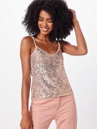 Žena v růžovém flitrovaném topu značky ABOUT YOU