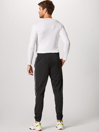 Nike Sportswear Survêtement en noir: Vue de dos