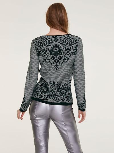 Megztinis iš heine , spalva - juoda / balta: Vaizdas iš galinės pusės