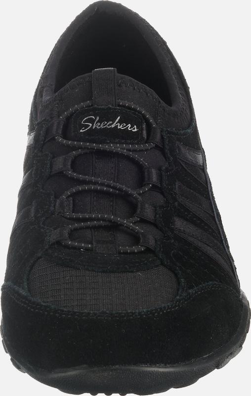 SKECHERS Rövid szárú edzőcipők fekete színben   ABOUT YOU