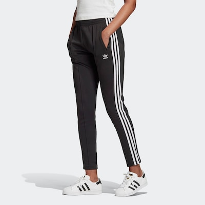 ADIDAS ORIGINALS Trousers in Black / White, View model