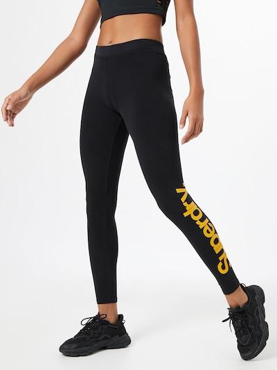 Superdry Leggings in goldgelb / schwarz, Modelansicht