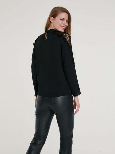 Bluză heine pe negru: Privire spate
