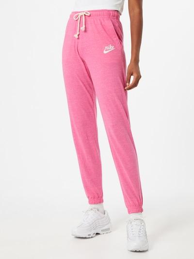 Nike Sportswear Spodnie w kolorze różowy / białym, Podgląd na modelu(-ce)