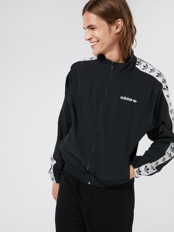 ADIDAS ORIGINALS Jacke 'TNT TAPE WIND J' in schwarz | ABOUT YOU