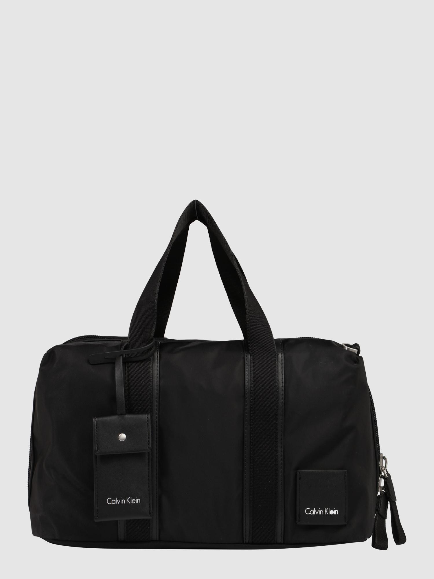 calvin klein handtasche 39 fluid duffle 39 in schwarz about you. Black Bedroom Furniture Sets. Home Design Ideas