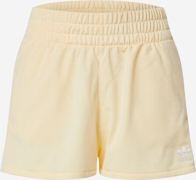 ADIDAS ORIGINALS Kalhoty - pastelově žlutá: Pohled zepředu