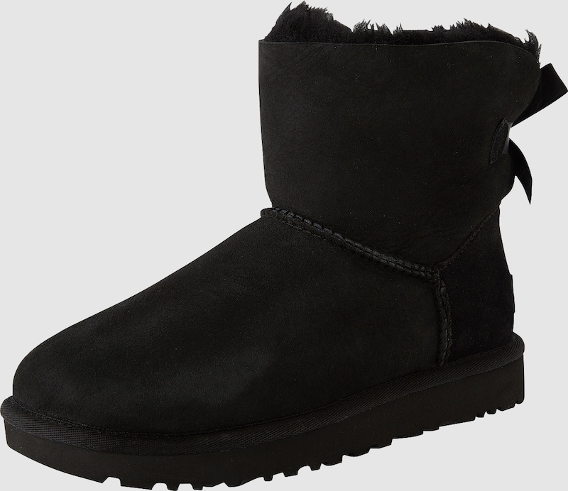 ugg boots mit fell f tterung 39 mini bailey bow ii 39 in schwarz about you. Black Bedroom Furniture Sets. Home Design Ideas
