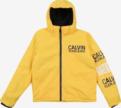 Calvin Klein Jeans Veste d'hiver 'STAMP LOGO HOODED SH' en jaune, Vue avec produit