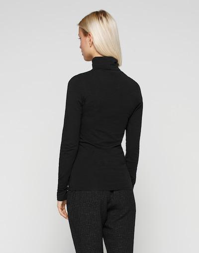 Maglietta modström di colore nero: Vista da dietro