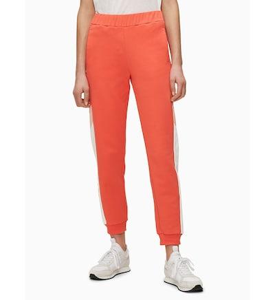 Calvin Klein Sweathose in orange / weiß, Modelansicht