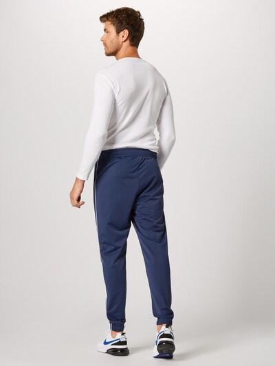 Nike Sportswear Survêtement 'M NSW CE TRK SUIT PK BASIC' en bleu foncé: Vue de dos