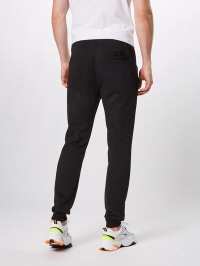 Urban Classics Pantalon en or / noir: Vue de dos
