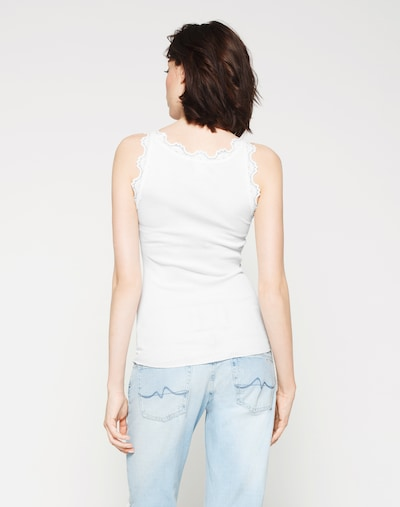 Top rosemunde di colore bianco: Vista da dietro