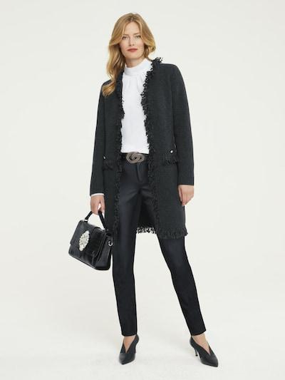 heine Manteau en tricot en noir, Vue avec modèle