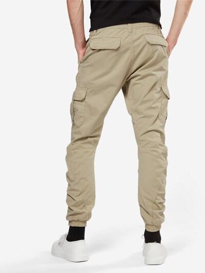 Pantaloni cu buzunare Urban Classics pe nisip: Privire spate