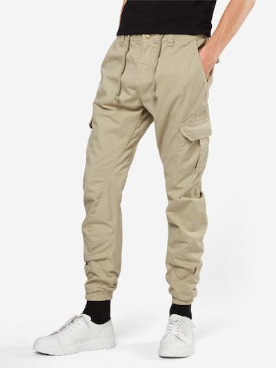 Pantaloni cu buzunare Urban Classics pe nisip: Privire frontală