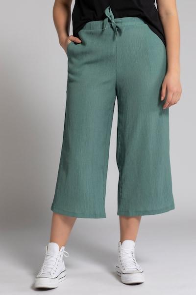 Studio Untold Hose in smaragd, Modelansicht