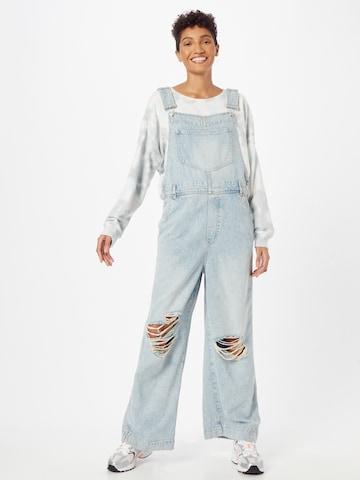 Jeans con pettorina di Free People in blu