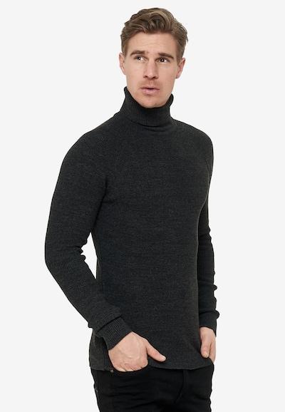 Rusty Neal Pullover mit stilvollem Rollkragen in schwarz: Frontalansicht