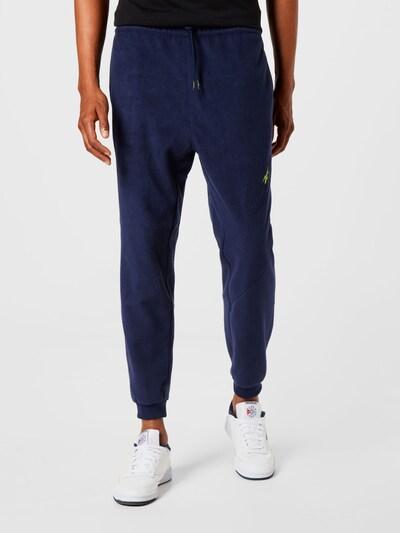 Reebok Sport Športové nohavice - námornícka modrá / žltá, Model/-ka