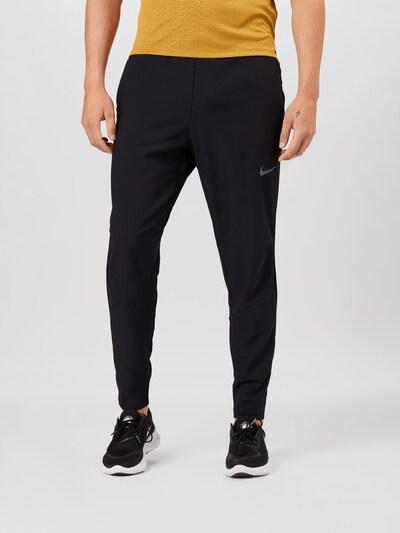 Pantaloni sport NIKE pe negru: Privire frontală