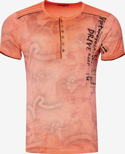 Rusty Neal T-Shirt mit lässigem Allover-Print in orange: Frontalansicht