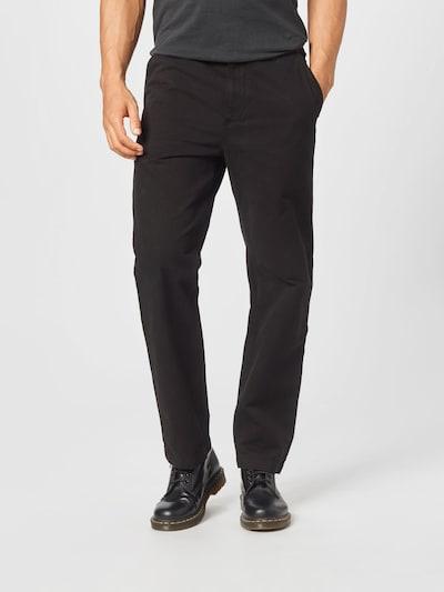 Carhartt WIP Jeans 'Wesley' i svart, På modell