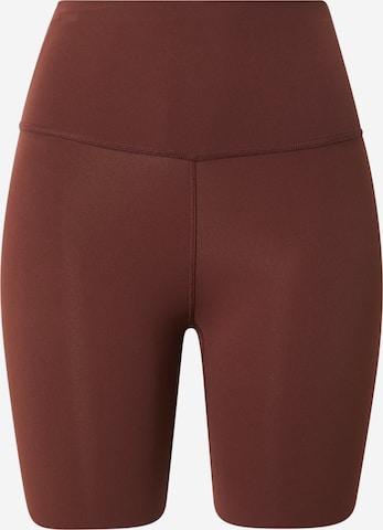 NIKE Urheiluhousut 'Luxe' värissä ruskea