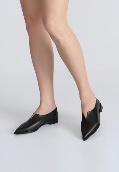 Ekonika Coole Slipper aus glattem Leder in schwarz: Frontalansicht