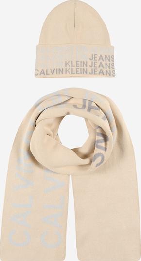 Calvin Klein Jeans Шапка в светлобежово / сиво, Преглед на продукта