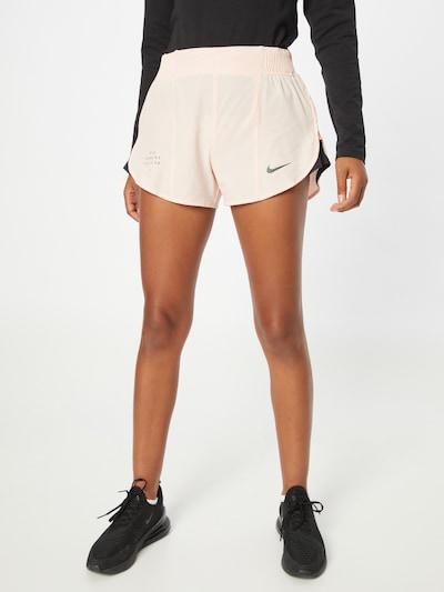 NIKE Pantalón deportivo 'Run Division Tempo Luxe' en rosa pastel / negro, Vista del modelo