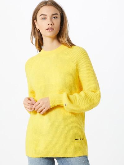 Tommy Jeans Pullover in gelb, Modelansicht