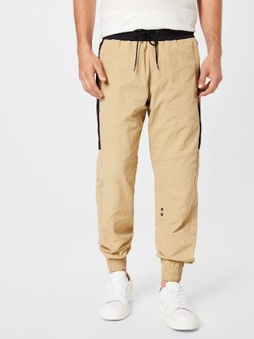 Pantaloni di Calvin Klein Jeans in beige