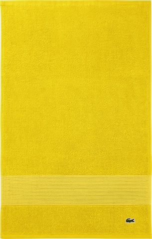 LACOSTE Towel in Yellow