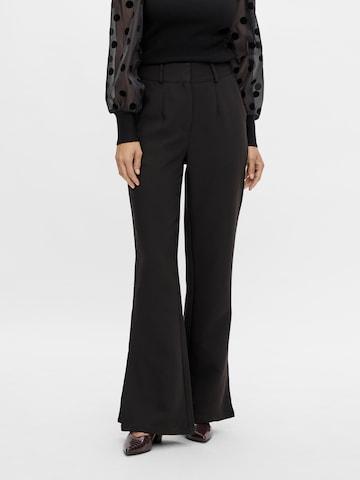 Pantaloni con pieghe 'Thea' di Y.A.S in nero