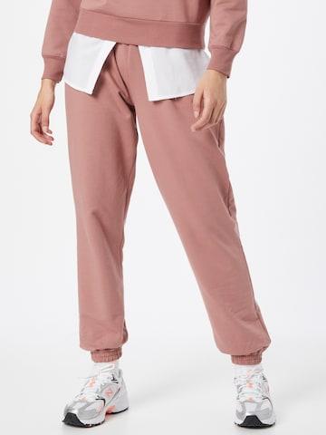 ABOUT YOU Püksid 'Naomi Sweat Pants', värv oranž