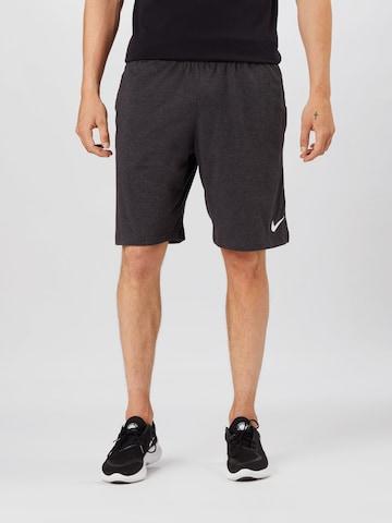 NIKE Sports trousers in Grey