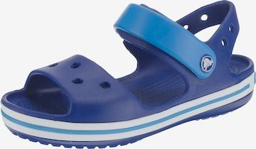 Pantofi deschiși de la Crocs pe albastru