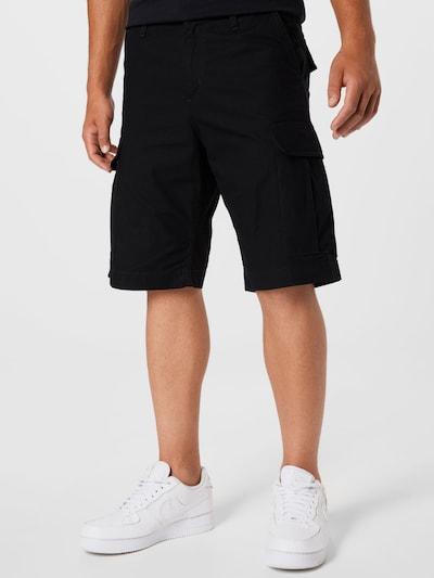 Carhartt WIP Pantalon cargo en noir, Vue avec modèle